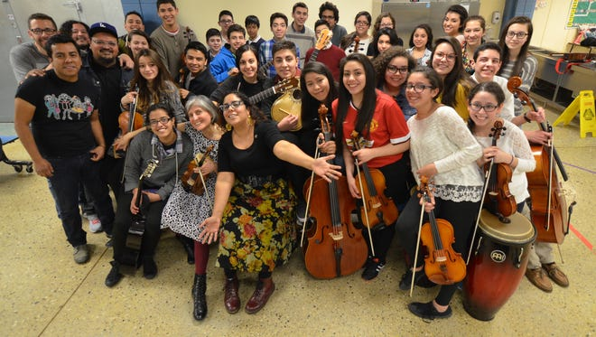 """The Latino Arts String Program in Milwaukee recorded with Grammy-winning Latin rock group La Santa Cecilia in 2015. The album featuring the collaboration, """"Buenaventura,"""" is up for a Grammy Award Sunday."""