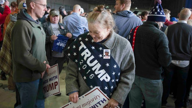 Linda Gore stands in the crowd as she waits for the arrival of Republican presidential candidate Donald Trump.