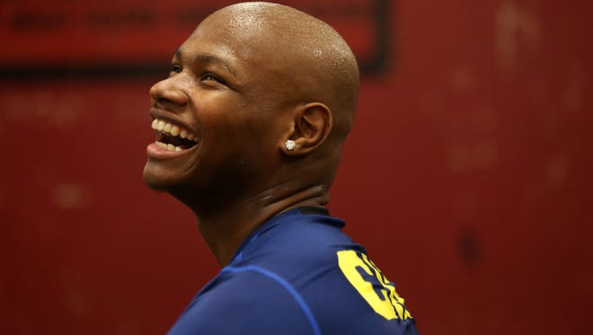 Florida High star football player and wrestler Cam Brown smiles with his former teammates as they work out at the school's gym. Brown passed away just two months later due to complications with Osteosarcoma, a type of bone cancer.