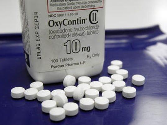 635786072721861442-oxycontin-pills