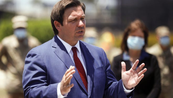 Gov. Ron DeSantis on May 8 at a news conference at the FITTEAM Ballpark of the Palm Beaches.