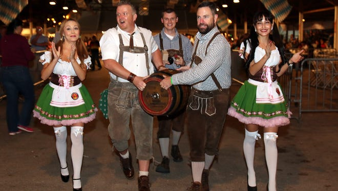 The first keg of Paulaner Oktoberfest beer is carried in to be tapped during the inaugural Authentic El Paso Oktoberfest in 2014. The German tradition returns to the El Paso County Coliseum from Sept. 16 to 18.