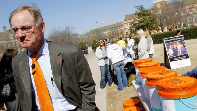 In this March 10, 2008 file photo, Oklahoma State University President Burns Hargis walks around campus in Stillwater, Okla. Oklahoma's two largest universities announced Tuesday, Oct. 6, 2020, that start of their spring semester will be delayed by one week and spring break is canceled because of the coronavirus pandemic.