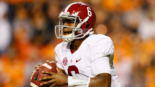 Vegas oddsmakers favor quarterback Blake Sims and Alabama to win the college football playoff.
