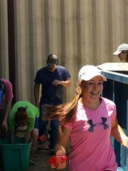 Volunteers with Student Life Ministries summer camp take some time off for a water balloon fight at Sonrisas Trails facilities in San Angelo, where they have been working for the last few days.