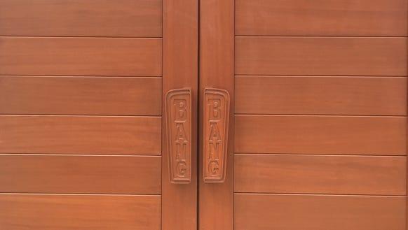 The custom-made handles on the 20-foot mahogany doors