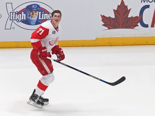 Jan 30, 2016; Atlantic Division forward Dylan Larkin (71) of the Detroit Red Wings reacts after participating in the fastest skater competition during the 2016 NHL All Star Game Skills Competition at Bridgestone Arena.