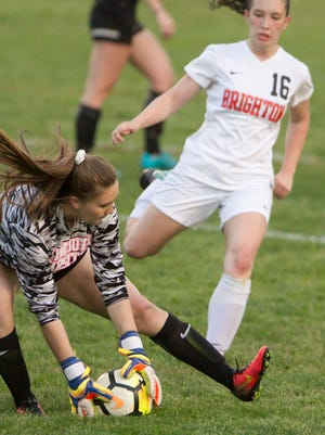 Plymouth goalkeeper Rebecca Przybylo stops Brighton's Alexis Shatrau from scoring in the second half of the game Thursday, May 10, 2018, at Brighton.