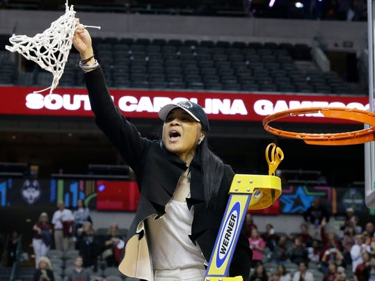 FILE- In this April 2, 2017, file photo, South Carolina coach Dawn Staley cuts down the net as she and the team celebrate their win over Mississippi State in the final of NCAA women's Final Four college basketball tournament in Dallas. South Carolina leaves June 27 and will play three games in Tokyo against Japan's national team before returning July 5. (AP Photo/LM Otero, File)