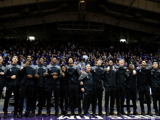 Northwestern players react during a NCAA Division I Men's Basketball Tournament Selection Show watch party Sunday, March 12, 2017 at Welsh-Ryan Arena in Evanston, Illinois. This is the first time that Northwestern Men's Basketball team has been selected to play in the NCAA Tournament. Northwestern will play against Vanderbilt in the first round. (AP Photo/Nam Y. Huh)