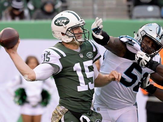New York Jets quarterback Josh McCown (15) throws a pass as Carolina Panthers outside linebacker Thomas Davis (58) adds pressure during the second half of an NFL football game, Sunday, Nov. 26, 2017, in East Rutherford, N.J. (AP Photo/Bill Kostroun)