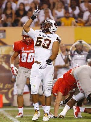 ASU's Salamo Fiso reacts after a tackle against New Mexico at Sun Devil Stadium on Sep. 18, 2015 in Tempe.