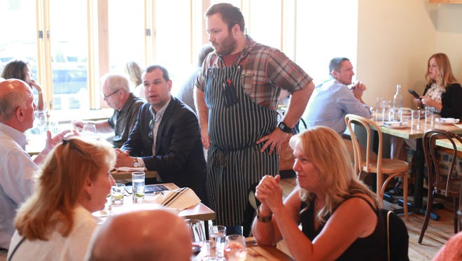 Gold Cash Gold chef Josh Stockton speaks to guests during the Detroit Free Press Top 10 Takeover dinner series at Gold Cash Gold in Detroit on Monday July 27, 2015