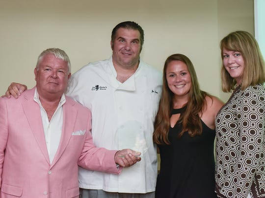 Jim Flynn, (left), Founder and Editor of Shorefoodie.com presents the Taste Award to Joe Leone of Joe Leone's Italian Specialties, Point Pleasant Beach and Sea Girt, who won for Outstanding Specialty Food Store. Accepting along with Leone are Elizabeth Bova and Cathy Feeney, (right).