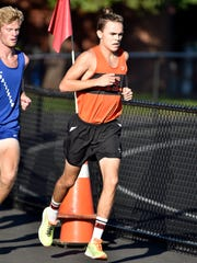 York Suburban's Jarrett Raudensky, center, leads the pack against Dallastown's Patrick Jacobson in a cross country meet Wednesday, Oct. 5, 2016, at York Suburban. The Dallastown girls cross country team delivered the York Suburban girls their first dual meet loss as a team since 2007.