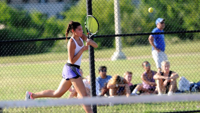 Wylie's Kaitlyn Hathorn follows through during the Class 4A mixed doubles semifinals at the UIL state championships in College Station on Thursday, May 17, 2018. Hathorn and partner Davyn Williford won 6-4, 6-4 to reach Friday's final.