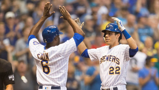 Christian Yelich  is greeted by  Lorenzo Cain after his home run in the fourth inning.