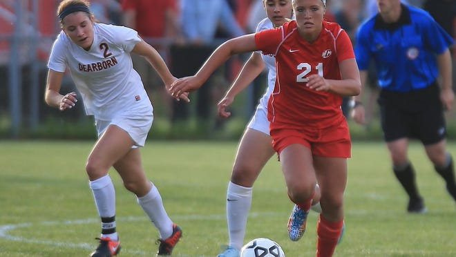 Racing into Dearborn's end of the field Tuesday is Canton senior Sarah Trapp (right), who scored both of her team's goals in a 2-0 victory.