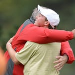 Fort Collins High School's Hunter Paugh hugs his dad after winning the state Class 5A golf tournament on Tuesday.