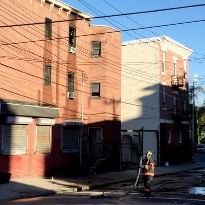 Firefighters on the scene of a third-floor apartment