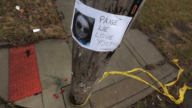 A small makeshift memorial stood at the corner of Charlevoix St. and Philip St. in Detroit today, one day after a gunmen opened fire on a car of teenagers that was parked on Philip St. Paige Stalker, a 16-year-old Grosse Pointe Woods girl was killed and three other teens were wounded in the attack, which police said did not appear to be random.