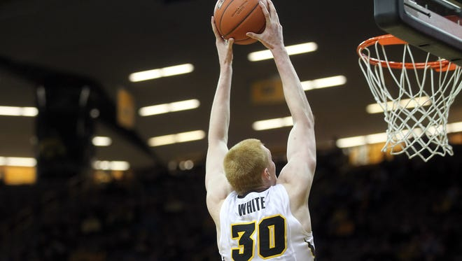 Iowa's Aaron White dunks the ball during the Hawkeyes' game against Nebraska at Carver-Hawkeye Arena on Monday, Jan. 5, 2015.   David Scrivner / Iowa City Press-Citizen