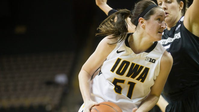 Iowa's Bethany Doolittle drives past Northwestern's Alex Cohen during their game at Carver-Hawkeye Arena on Wednesday, Jan. 15, 2015.