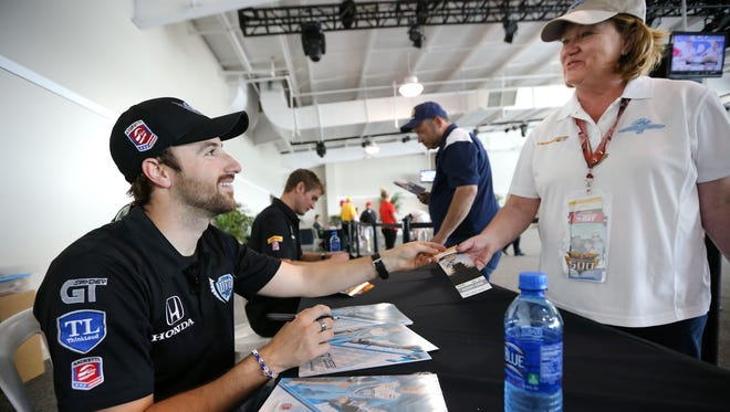 Driver autographs, like this one given by James Hinchcliffe, were a large component of previous Community Days at IMS.