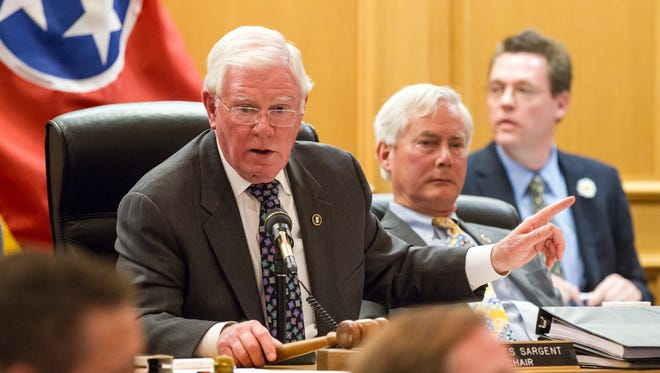 Tennessee GOP Rep. Charles Sargent of Franklin, Tenn., presides over a raucous Senate Finance Committee in March 2015 in Nashville on the guns in parks bill.
