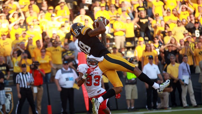 Iowa wide receiver Derrick Willies pulls in a pass in the end zone during the Hawkeyes' game against Ball State at Kinnick Stadium on Saturday, Sept. 6, 2014. David Scrivner / Iowa City Press-Citizen