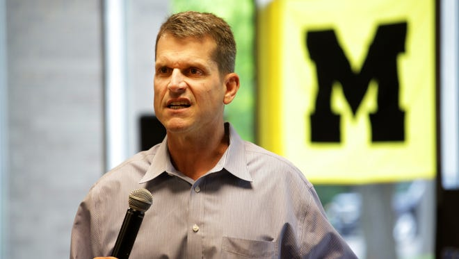 Michigan coach Jim Harbaugh speaks during the Michigan Football Clinic at the Horatio Williams Foundation building in Detroit on Wednesday, May 27, 2015.