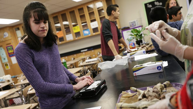Haley Sumner, 18, uses her Braille Sense communicator to complete an anatomy lab exercise at Ben Davis High School. Sumner is a blind Ben Davis senior who won a Lilly Endowment Community Scholarship to Butler University.