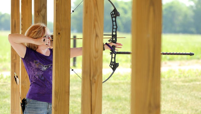 Robyn Garcia of Westfield lines up to take a shot at the Strawtown Koteewi Sport & Target Archery Range.
