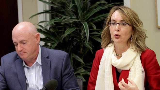 Former U.S. Rep. Gabby Giffords and her husband, Captain Mark Kelly speak in support of Oregon gun legislation at the Center for Hope and Safety in Salem on May 13.