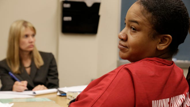 Mitchelle Blair is seated in Wayne County Circuit court.