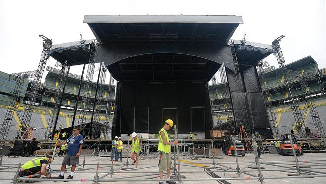 The massive main stage neared completion Thursday for Saturday's Kenny Chesney concert at Lambeau Field.