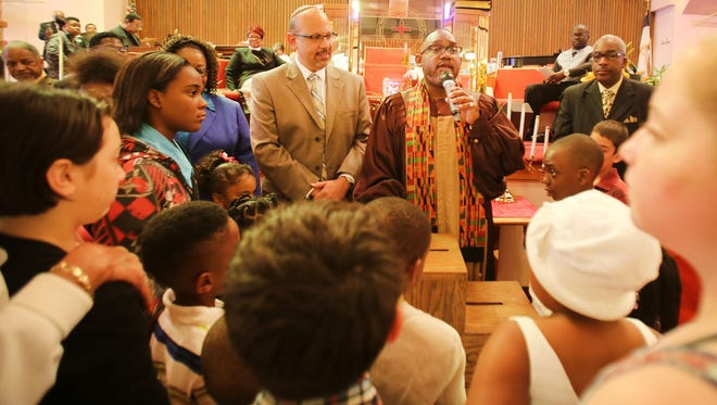 The Rev. Kenneth Flowers, right, of Greater New Mt. Moriah Missionary Baptist Church conducts the children's service with Rabbi Mark Miller of Temple Beth El.