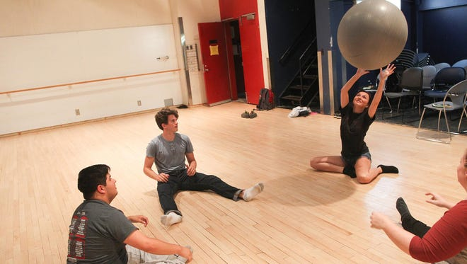 Sasha Hildebrand, bottom right, leads a teamwork-building exercise in her Basic Acting course at the University of Iowa Theatre Building on Wednesday, July 1, 2015.