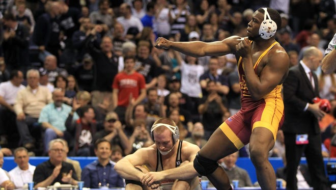 Iowa State's Kyven Gadson celebrates his pin on Ohio State's Kyle Snyder in the 197 pound NCAA Championship at the Scottrade Center in St. Louis, Mo. on Saturday, March 21, 2015. Gadson pinned Snyder in 4:24. David Scrivner / Iowa City Press-Citizen