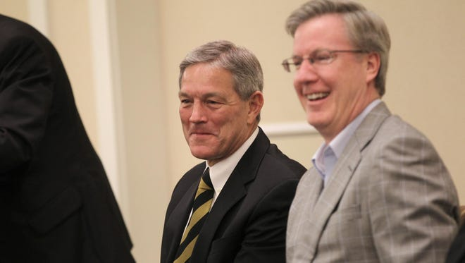 Iowa football coach Kirk Ferentz, left, and men's basketball coach Fran McCaffery watch as raffle tickets are drawn at the Johnson County I-Club breakfast on Nov. 1, 2013.