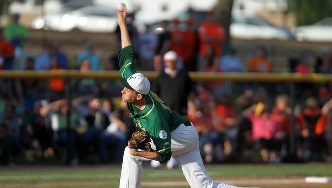 West High's Austin Miller delivers a pitch during the Trojans' game at Cedar Rapids Prairie on Wednesday, July 22, 2015.   David Scrivner / Iowa City Press-Citizen