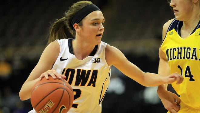 Iowa's Ally Disterhoft drives to the hoop during the Hawkeyes' game against Michigan at Carver-Hawkeye Arena on Thursday, Jan. 22, 2015. David Scrivner / Iowa City Press-Citizen
