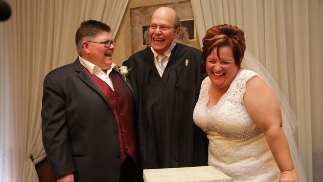 April DeBoer, left,  and Jayne Rowse are legally married by Judge Bernard Friedman at a banquet hall in Southfield on Saturday, Aug. 22, 2015.