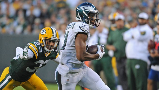 Green Bay Packers defender Micah Hyde (33) tries to tackle receiver Jordan Matthews (81) after a catch against the Philadelphia Eagles at Lambeau Field August 29, 2015.