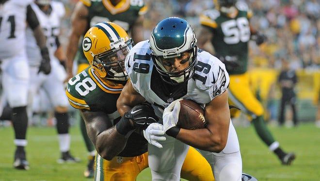 Green Bay Packers linebacker Sam Barrington (58) tackles Miles Austin (19) against the Philadelphia Eagles at Lambeau Field August 29, 2015.