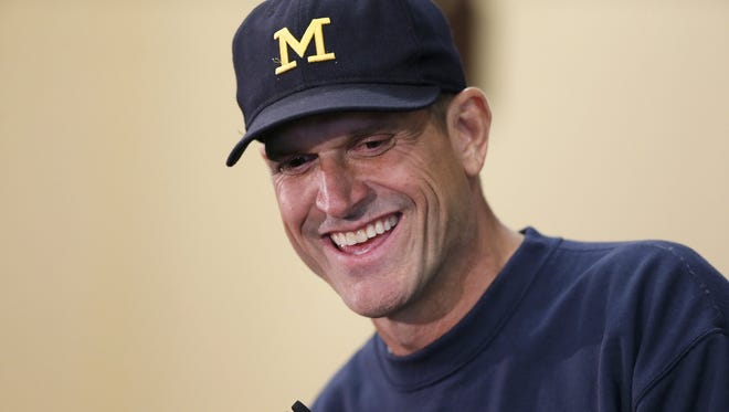 Michigan football head coach Jim Harbaugh while addressing the media during media day Aug. 6, 2015, in Ann Arbor.