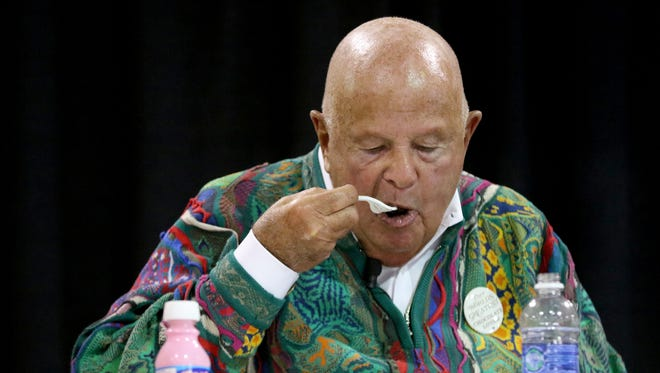 Gerry Frank tastes a cake during the 56th annual Gerry Frank Chocolate Layer Cake Contest at the 150th Oregon State Fair in Salem on Sunday, Sept. 6, 2015.