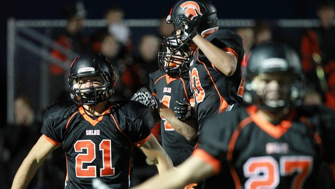 Solon teammates celebrate during a game against Cedar Rapids Xavier at Sept. 11. The Spartans travel to Washington looking to avenge a matchup with another top-tier team.