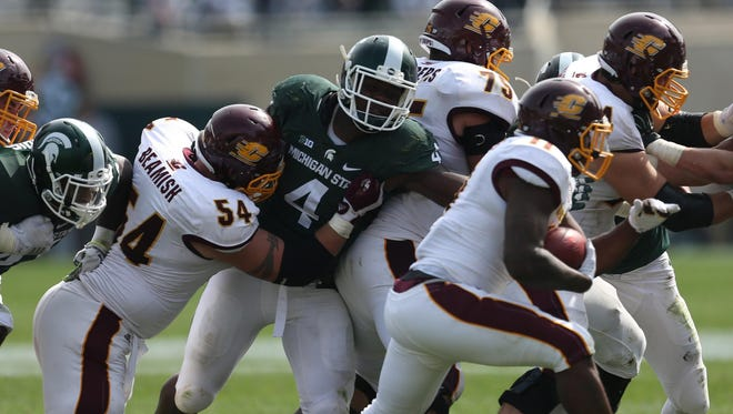Michigan State's Malik McDowell pursues Central Michigan's Jahray Hayes during second half action in September.