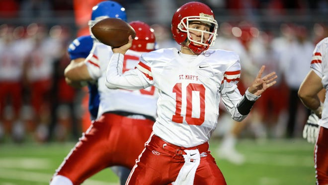 Orchard Lake St. Mary's  Quarterback Brendan Tabone throws the ball during the first half of the varsity football game at Novi Detroit Catholic Central in Novi, Mich. on Friday, Oct. 9, 2015.